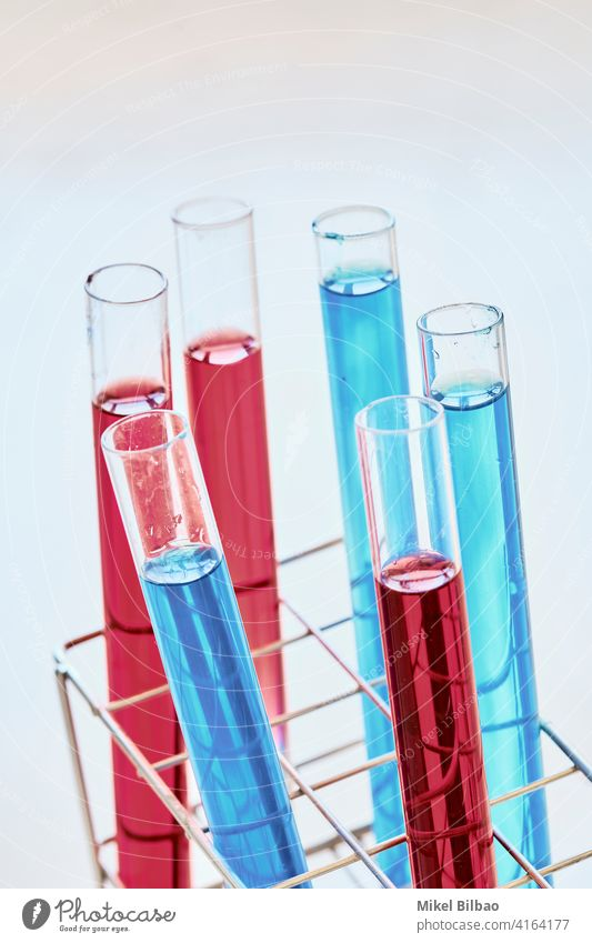 Test tubes with dye liquid in a laboratory. Science concept. research science scientific scientific research Testing & Control test knowledge background school