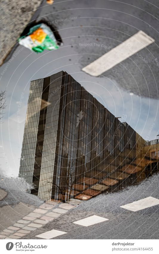 Reflection of the Axel Springer building with a chip bag Structures and shapes architectural photography architecture Central perspective Deep depth of field