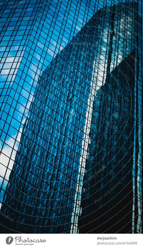 High-rise building in Mainhatten City. - Frankfurt a/ M - Shiny windows, steel in light and shadow. Towering and reflecting. Architecture Sky Modern Window Blue