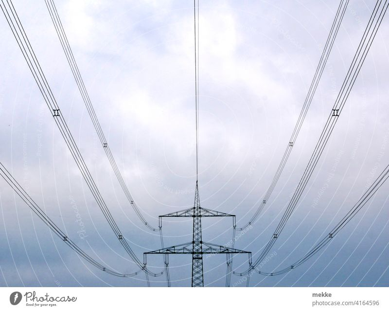 Symmetrical power lines against cloudy sky Electricity pylon stream Transmission lines Energy industry Cable Sky High voltage power line Power transmission
