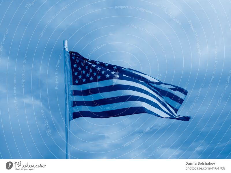 American flag on a blue sky with clouds background american united white usa states waving red wind patriotic stripes patriotism symbol pole banner july 4th