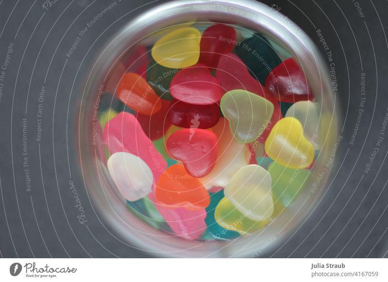 Bird's eye view of a jar filled with heart gummy bears Gummy bears Heart Heart-shaped sweetheart Heart shape motley variegated vegan Glass Bird's-eye view pink