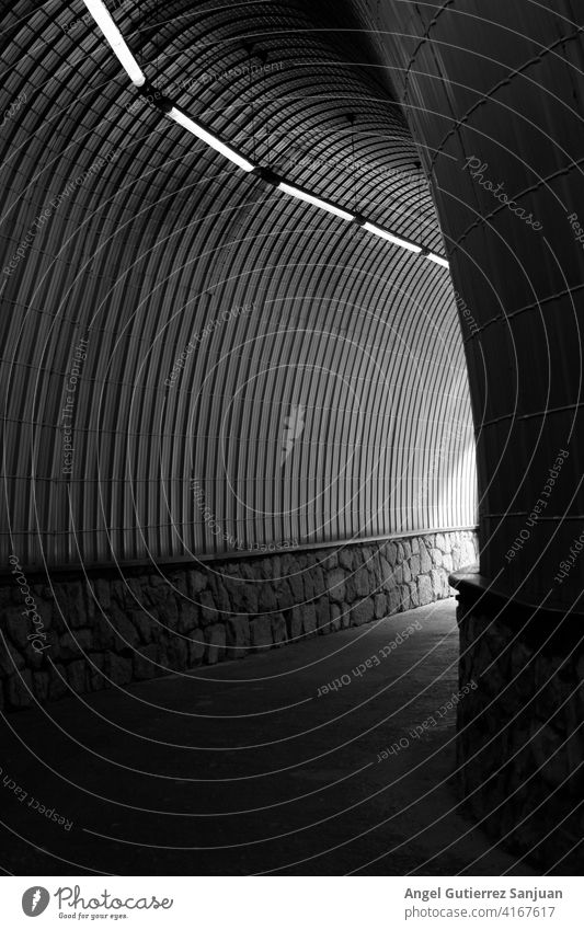 black and white tunnel with lights and stones way abstract detail line outdoors road architecture artistic auto automobile curve drive driving fast grey highway