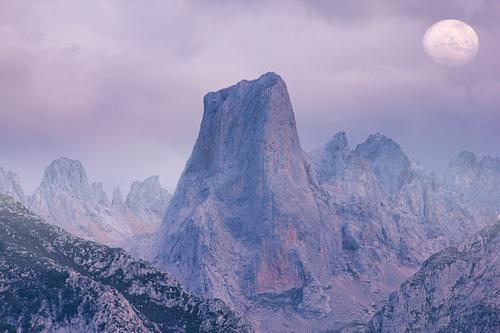 El Naranjo de Bulnes mountain peak in Picos de Europa, Asturias, Spain panorama scenery sunrise meadow geologic hiking light national rock rural scenic blue