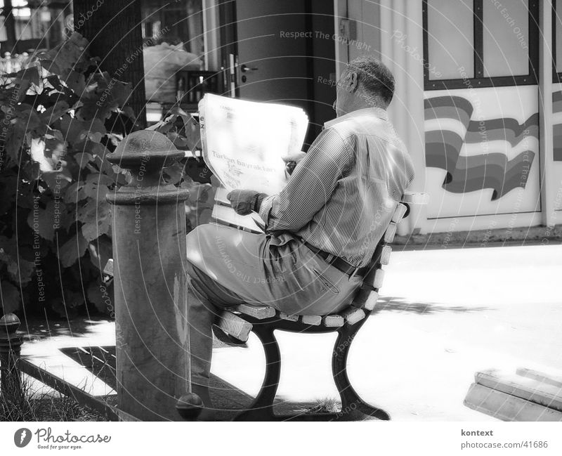 Man Contentment Reading Newspaper Park bench