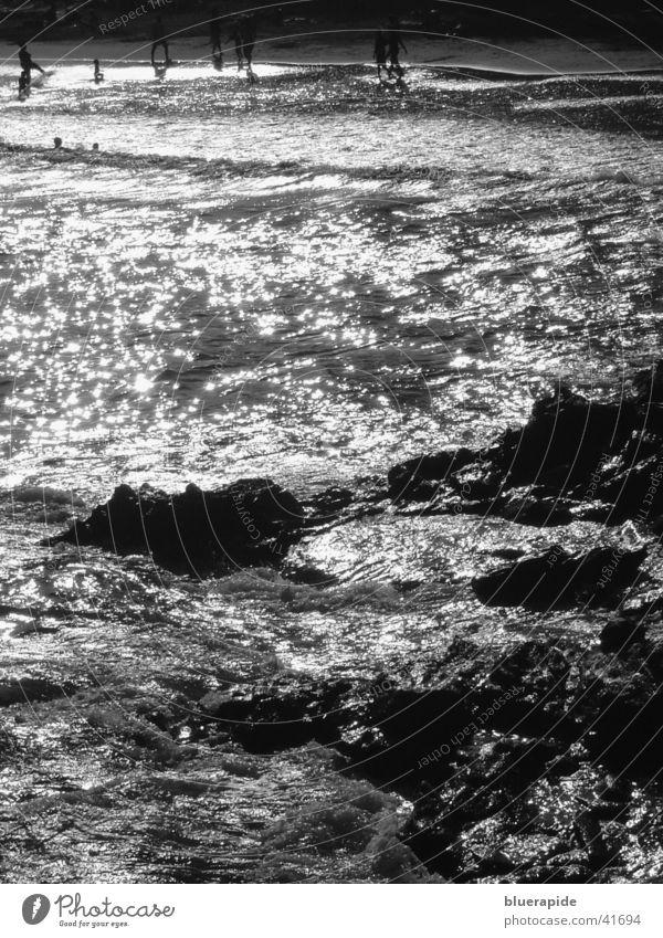 Human being Water Ocean Beach Lamp Stone Moody Waves Coast Glittering Wind Rock Swimming & Bathing