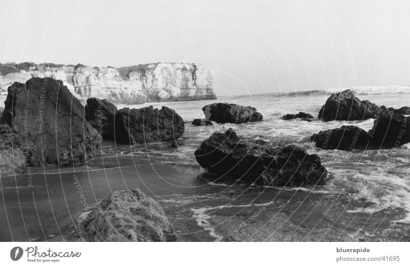 Rocky coast near Portugal Ocean Beach Black White Moody Horizon Coast Water Sand Stone Fragment Bay Idyll