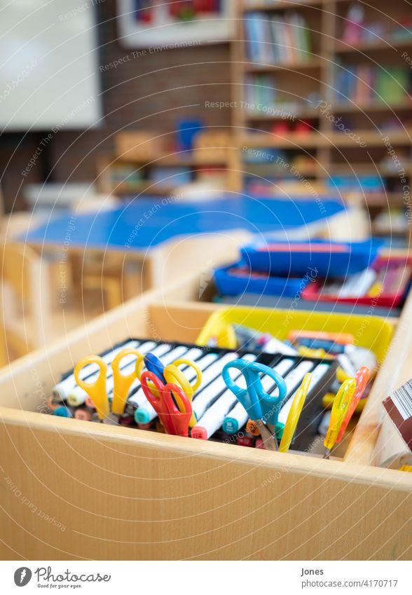 Pens and scissors at school School pens Claw variegated Kindergarten Wood blurred colourful Interior shot children fun Handicraft