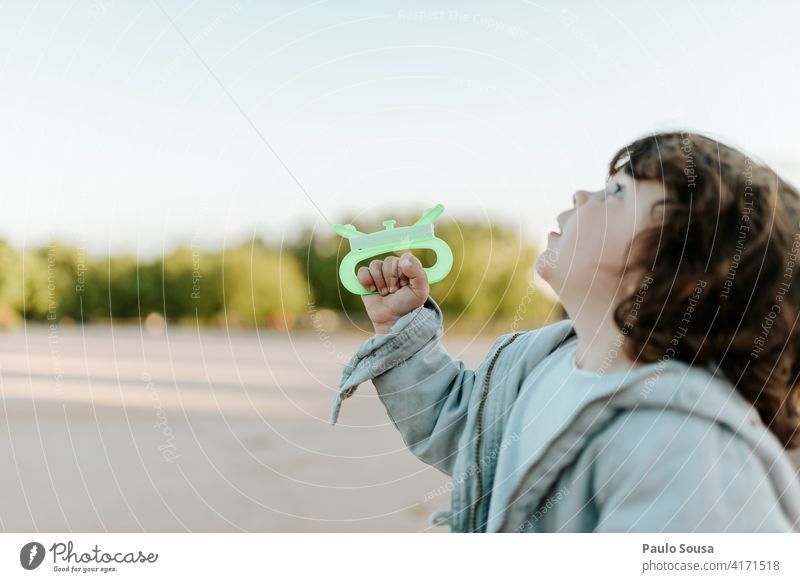 Cute child playing with kite Kite Child childhood 1 - 3 years Caucasian Girl Authentic Spring Colour photo Exterior shot Lifestyle Infancy Day Childhood memory