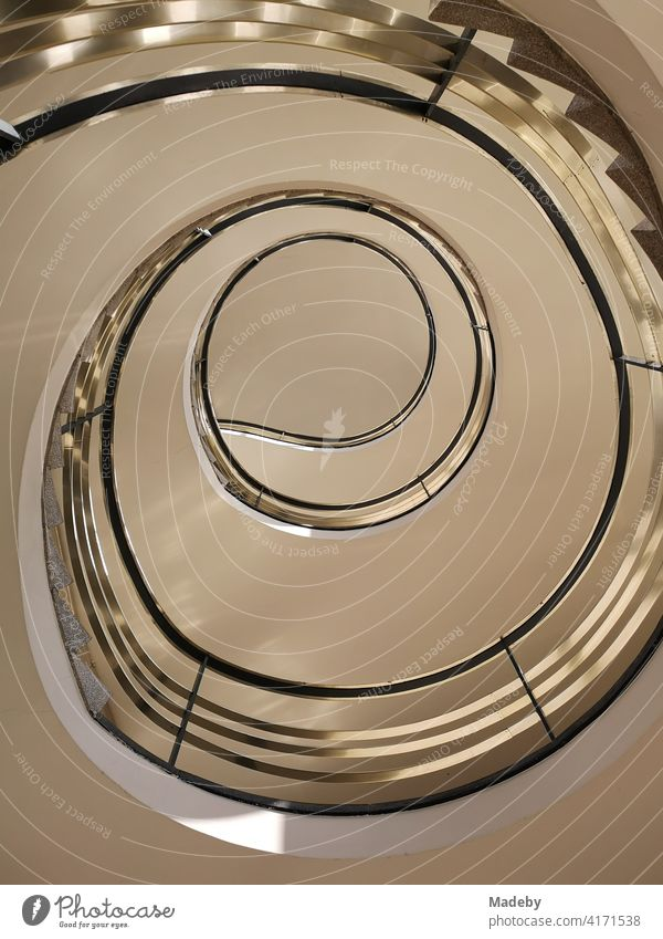 Curved staircase in the style of the architecture of the fifties in an office building in the West End of Frankfurt am Main in Hesse Stairs Staircase (Hallway)