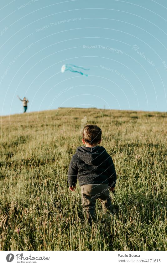 Rear view child looking at Kite Child 1 - 3 years Playing Boy (child) Infancy Human being Toddler Colour photo Joy Happiness Leisure and hobbies Nature Life