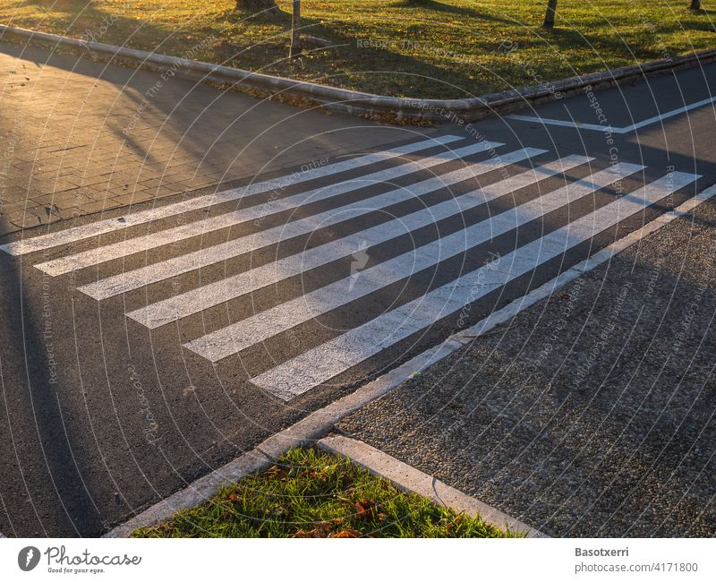 Zebra crossing over a bike path at sunset cycle path Bicycle nobody Deserted Transport Street Sunset Light Pedestrian Footpath Intersection Yield sign