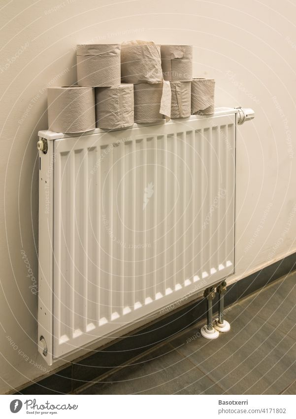 Toilet paper on a radiator LAVATORY Stack Coil toilet paper Toilet paper roll Heater Building hygiene coronavirus Sanitary Living or residing Bathroom Clean