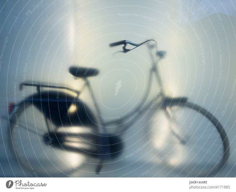 Silhouette of a bicycle Bicycle Shop window Reflection blurriness Light (Natural Phenomenon) hollandrad New Hazy Artificial light Subdued colour Store premises