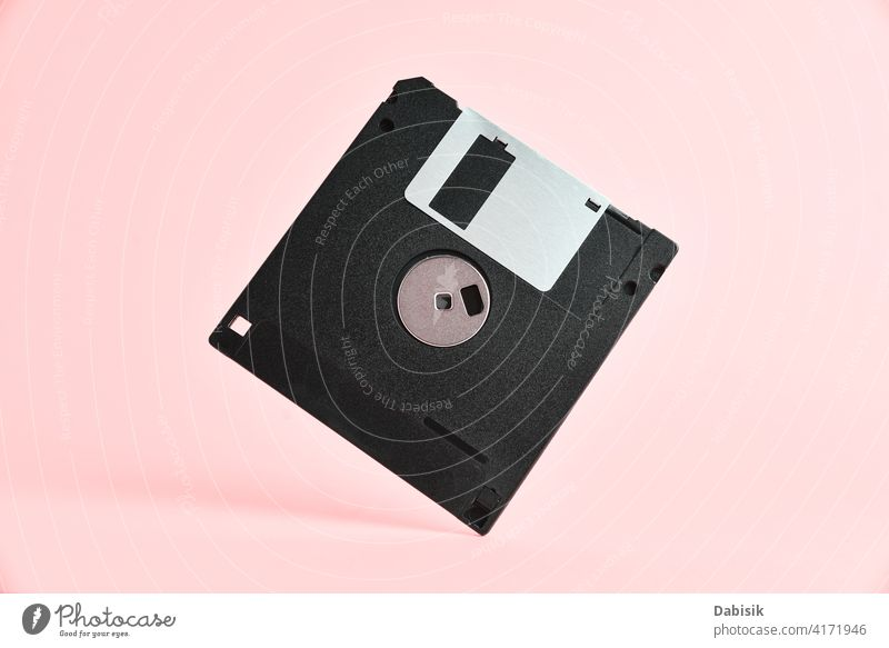 Floppy disk on pink background diskette floppy retro storage computer design abstract vintage office technology data information memory magnetic business black