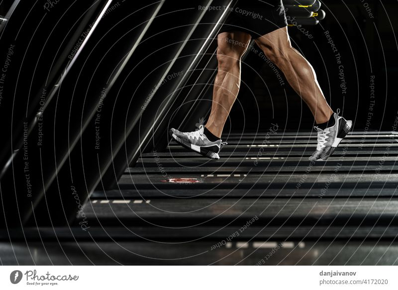 strong man running on treadmill action active activity adult athlete athletic care club equipment fitness foot gym health healthy jogger leg lifestyle machine