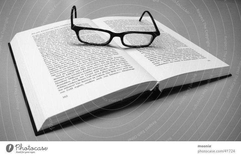 Break from Putin's Bio Book Eyeglasses Reading Think Leisure and hobbies Black & white photo ponder