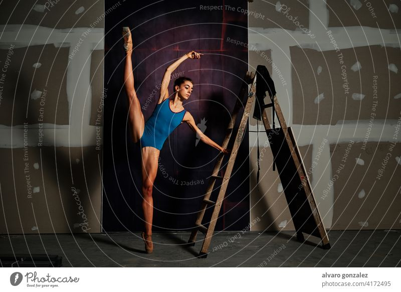 young female ballet dancer at the studio performance flexibility dancing femininity stretching split graceful theatrical professional ballerina performer