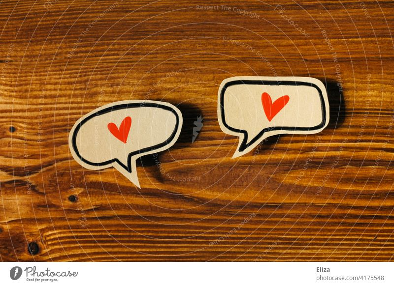 Two speech bubbles with red hearts. Loving, appreciative communication. Love cuddle Couples Relationship In love Emotions Red Infatuation Communicate