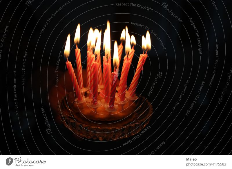 Small cake with candles on a dark background flame small sweet birthday celebration decoration dessert food happy party holiday bright frosting white celebrate