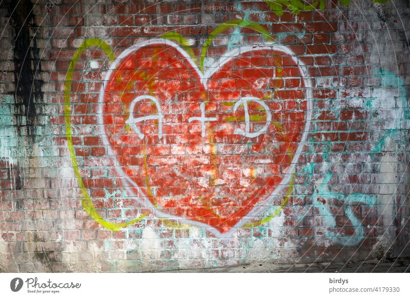 Graffiti, big red heart on a brick wall with the initials of two lovers Love Heart In love Infatuation Display of affection With love Declaration of love