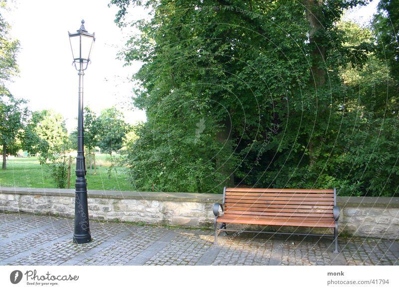 empty park bench & lantern Park Lantern Historic Street lighting Bench Cobblestones Exterior shot