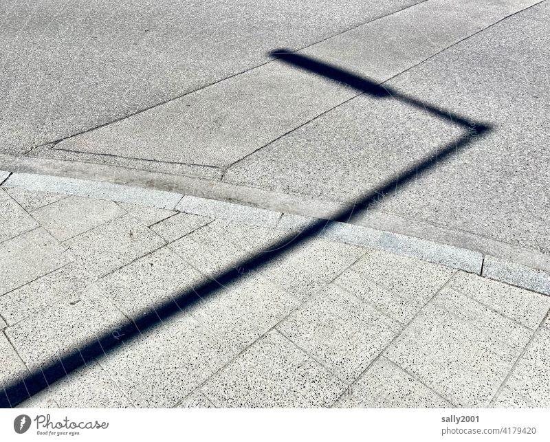 the shadow from the light... streetlamp street lamp Street Asphalt off Sidewalk Shadow shadow cast Sunlight Light Lanes & trails Deserted Pavement Gray