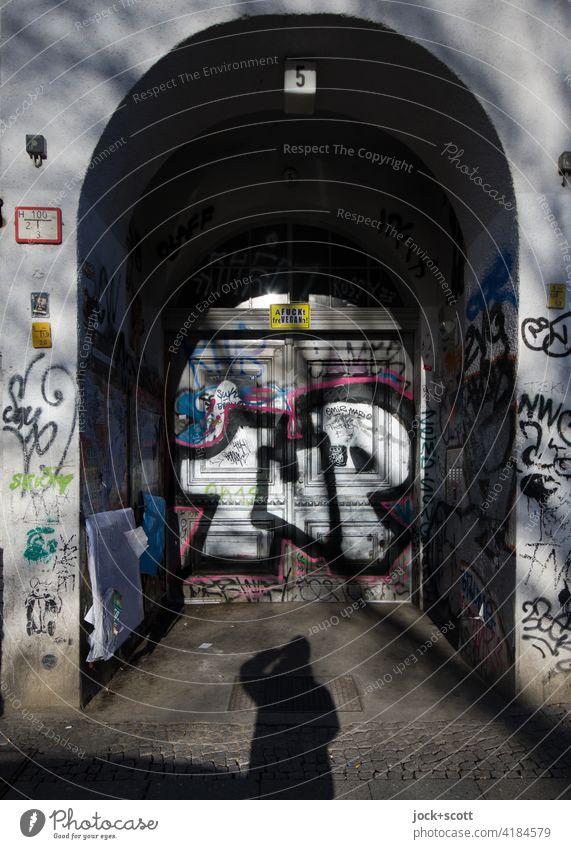 objective l graffiti in front of the door Front door Entrance Graffiti Creativity Lack of inhibition Kreuzberg Berlin Street art Characters Vandalism Round arch