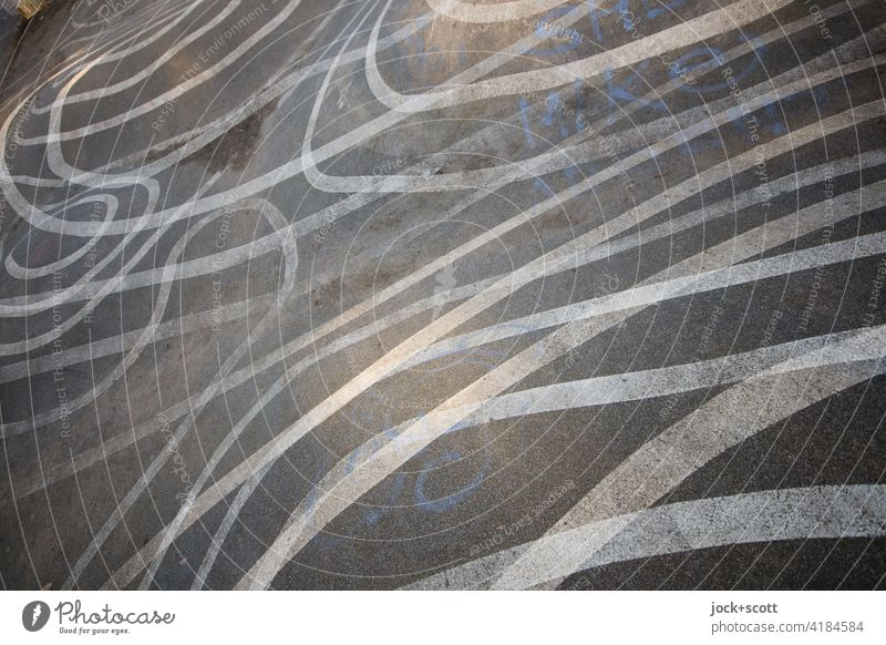 criss-crossing lines on asphalt Line Many Double exposure Reaction Illusion Abstract Structures and shapes Irritation Uneven Ground markings Skate park Complex