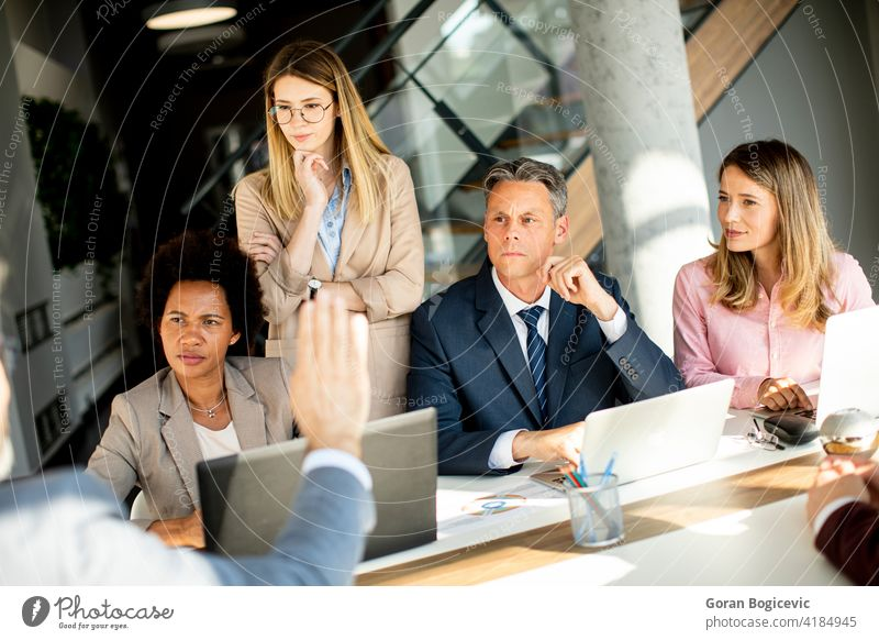 Multiethnic group of business people working together and preparing new project on a meeting in office black brainstorming businessman businesswoman colleagues