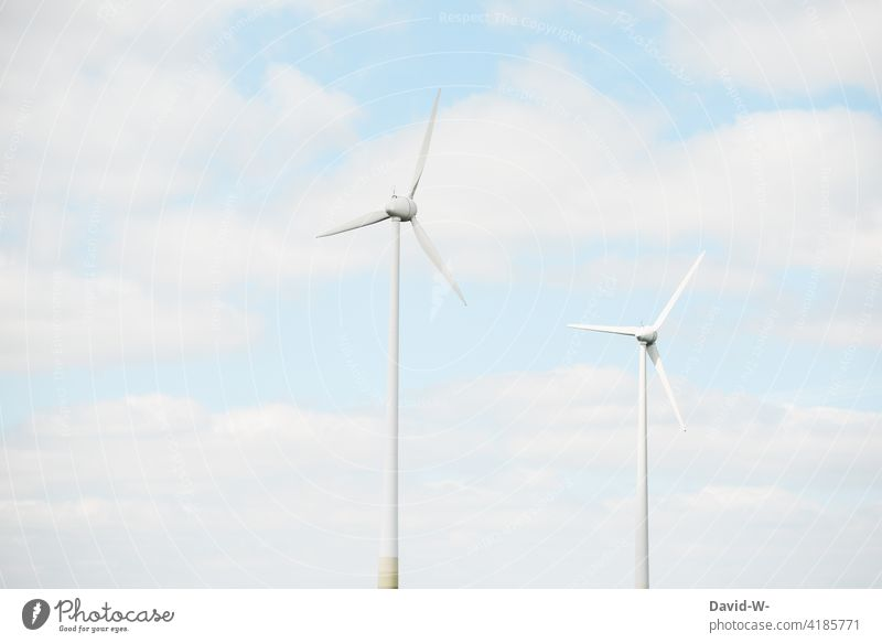 Wind turbines and clouds windmills wind power power supply co2 eco-power Climate protection Climate change Sustainability Eco-friendly Clouds