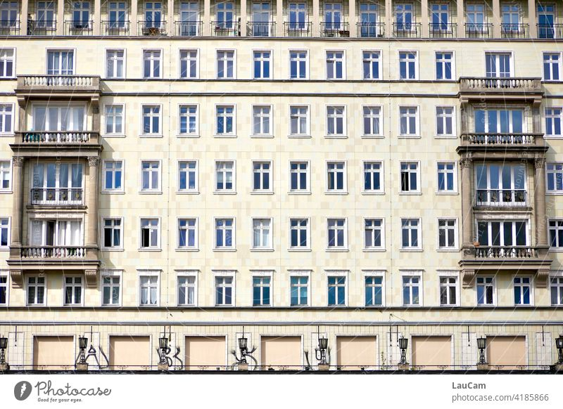 Candy-striper style apartment block on Frankfurter Allee in Berlin block of flats sugar cake style Facade house facade GDR architecture Window lamps Apartments