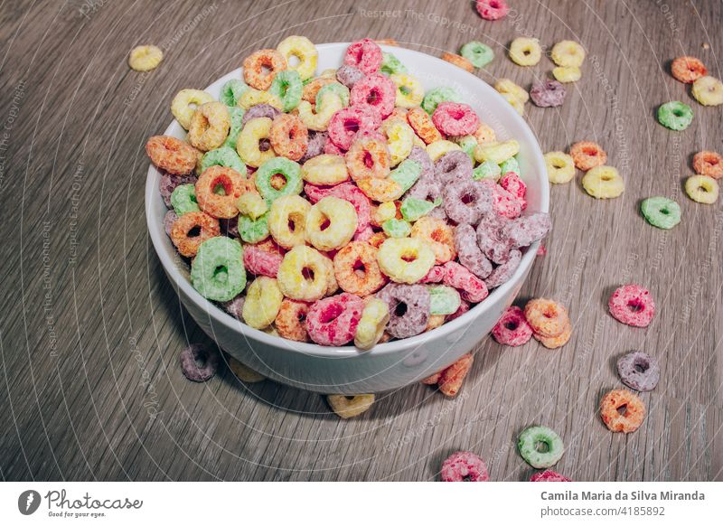 Colorful cereal  in a bowl for breakfast. background box carbs colorful delicious dessert floor food fresh fruit green home kids loops milk morning nutrition