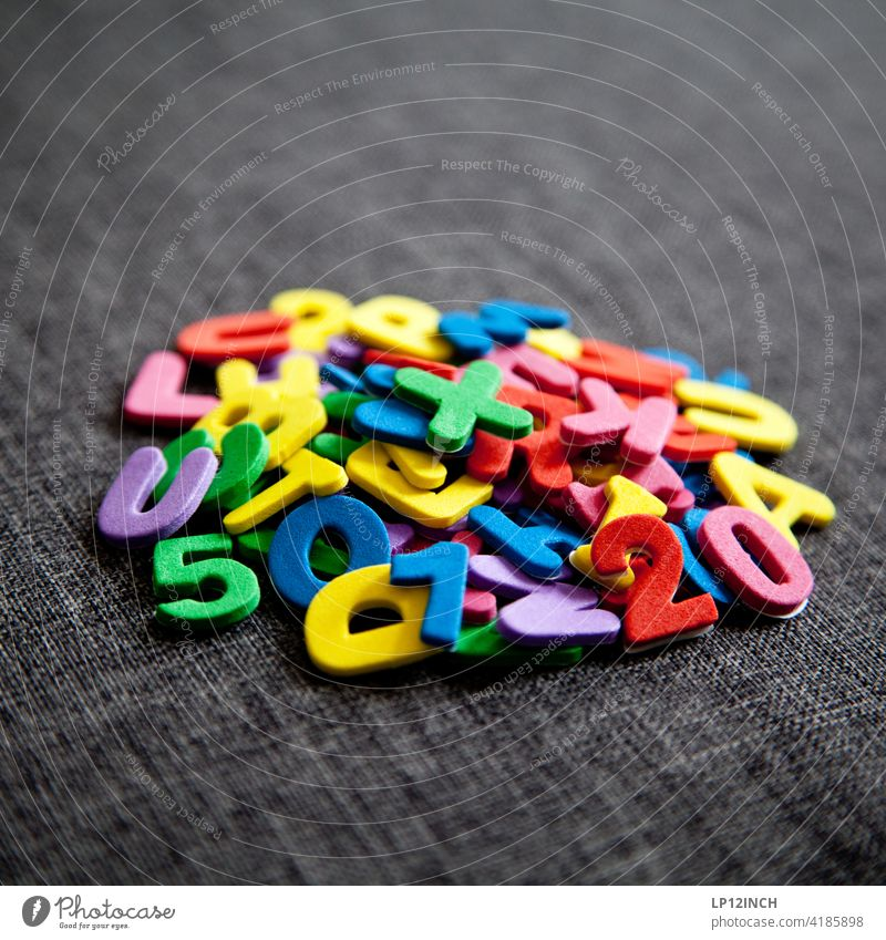 A bunch of characters Letters (alphabet) figures stickers Muddled sticking Heap Digits and numbers Characters Typography Sign amass consolidate variegated