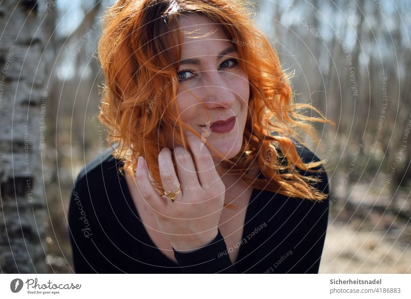 portrait Face Woman Young woman Long-haired pretty Colour photo red hair Exterior shot Wind windy Face of a woman Head Contentment Freedom Curl