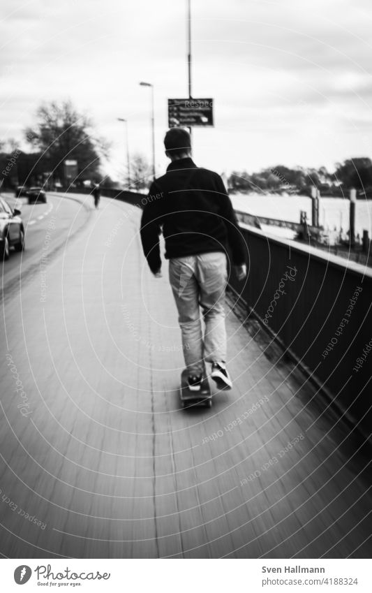 fast skater on the footpath Speed Driving swift Skateboard street Sports Lifestyle urban skateboarder youthful Outdoors Skateboarding Board fun free time