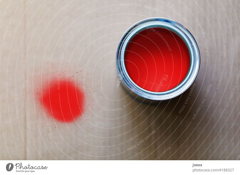 Red paint in paint pot, splash on cardboard Colour Cardboard Colour pot Paint bucket Round blob Colour photo Close-up Shadow Painting (action, work)