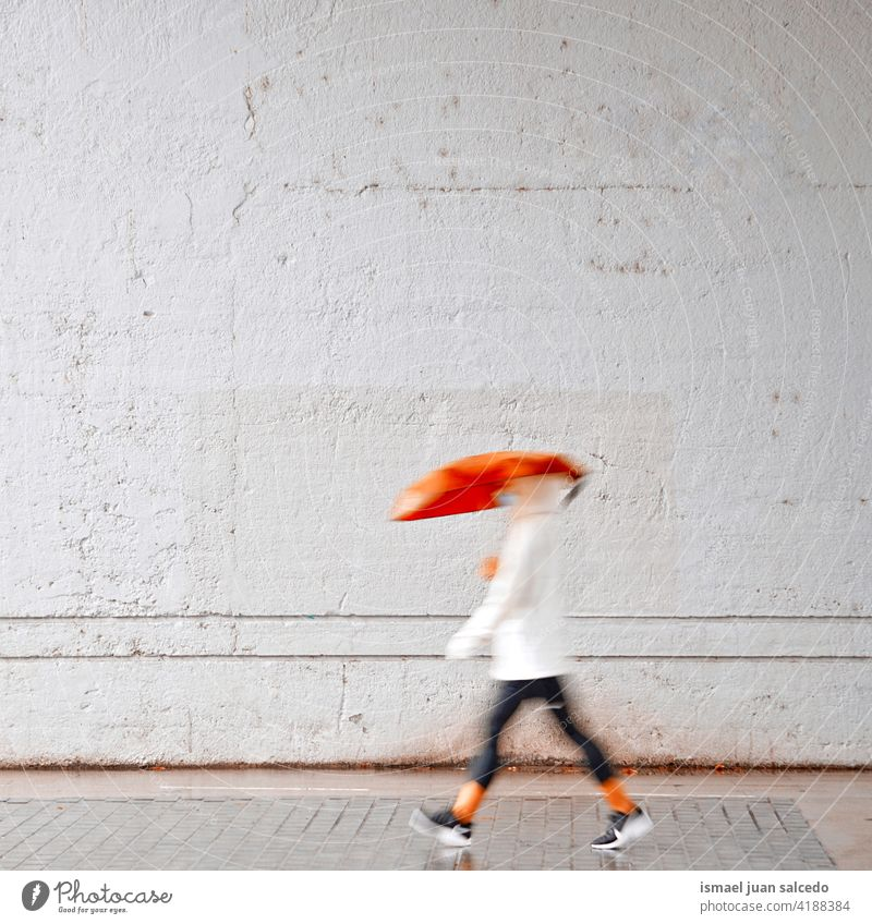 Woman with a red umbrella on the street in rainy days more adult person Umbrella Rain rains Day Water human Pedestrian Street City urban Bilbao Spain Walking