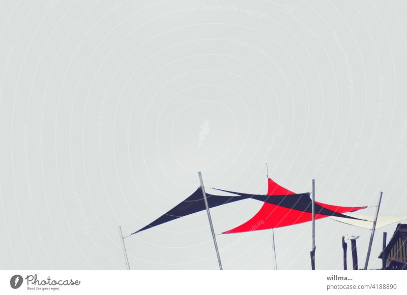 expectantly stretched awnings sun protection Sun sail Triangle Awning poles Copy Space Neutral background Summer Sun sail mast Pole Sun roof Red spanned