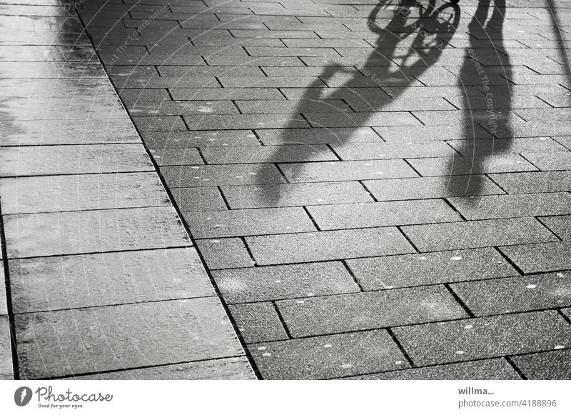 Dialogue of an encounter persons Shadow people conversation meetings Pedestrian cyclist communication chat Places walkway slabs Communicate Footpath