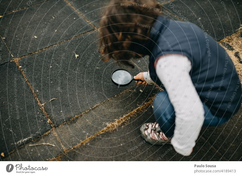 Child explore with magnifying glass Magnifying glass Girl 1 - 3 years Caucasian Ant Happy Curiosity Lifestyle Exterior shot Human being Nature Joy Playing