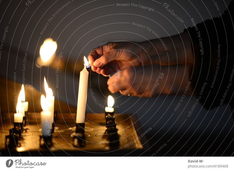 light a candle in church Prayer shoulder stand Church Religion and faith Grief Candlelight Ignite tranquillity pray Hope