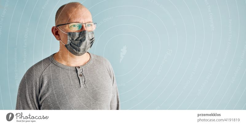 Man patient with face mask. Wearing coronavirus covid-19 protection medical mask during the pandemic person male disease health care hygiene copy space man