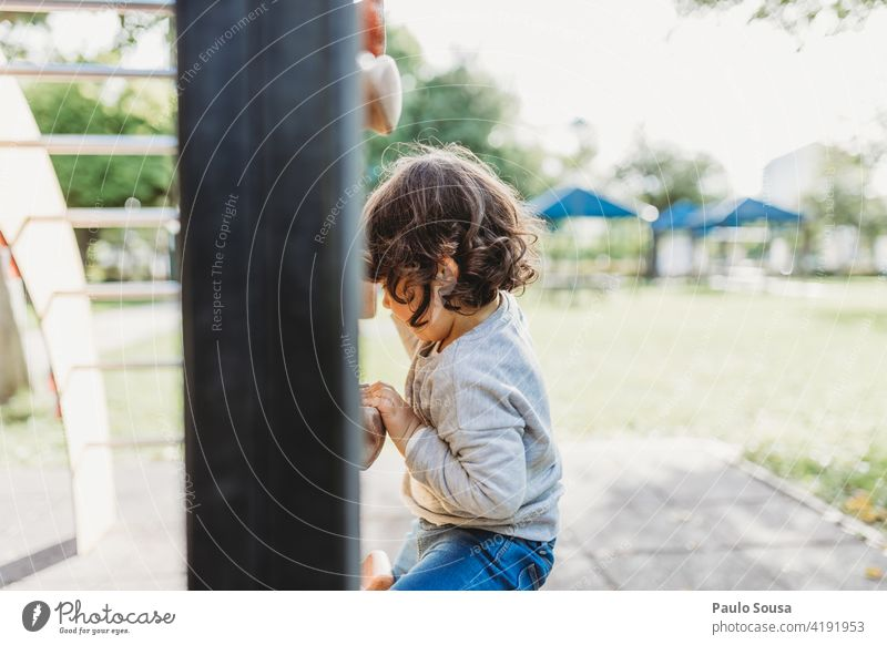 Cute girl playing at playground Climbing wall Child childhood 1 - 3 years Caucasian Girl Playing Playground Happy Happiness Leisure and hobbies Colour photo Joy