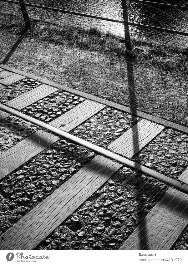 Old railway tracks on the promenade at the Duisburg inner harbour in black and white Inner Harbour Track rails Promenade Tourism Town Railroad Transport