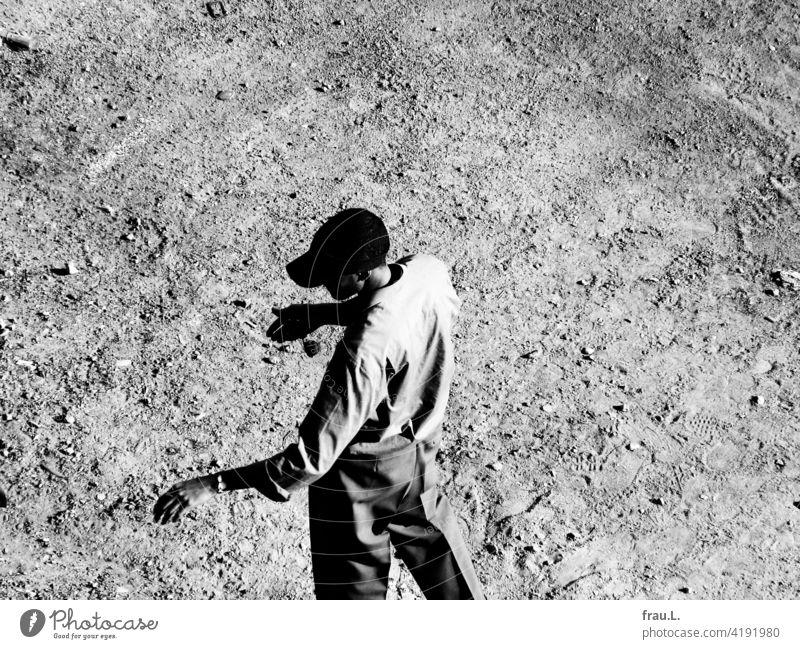 A tall, slender man. Man Thin Lanky Shirt cap sun cap Places Stand Elegant body-conscious