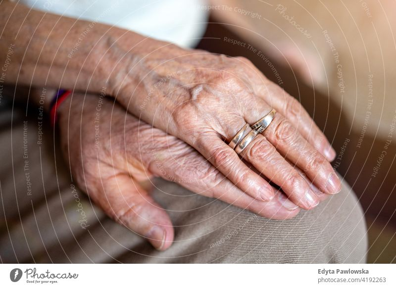 Close up of senior couple holding hands patient caucasian health support closeup aging aged wrinkled finger skin human care grandparents pensioners grandfather