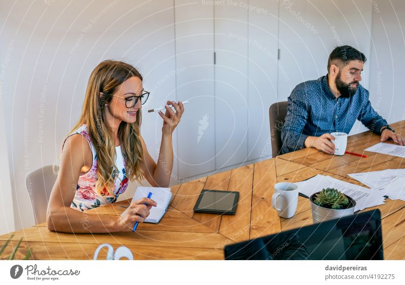 Office worker talking mobile phone with speaker office worker businesswoman talking speaker cell phone coworkers disturb conversation smiling startup