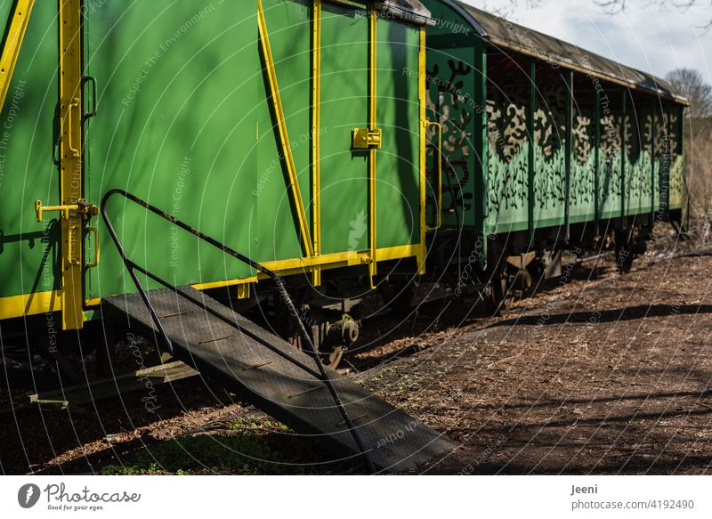 back to the roots | when riding a train was still an experience | old green train cars with ramp Track Train station railcar Wagons Ramp Access ramp