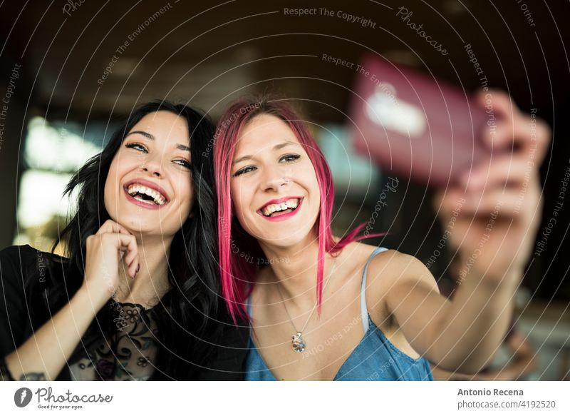 happy woman taking self portrait in bar smiling and posing young attractive 20s joy people person youth urban women pretty pretty people selfie Self portrait